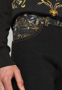 Versace Jeans Couture - COAL LAVEA  - Shorts - black - 4