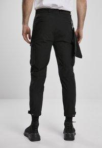 Urban Classics - Cargo trousers - black - 2