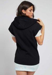 Guess - LOGO-TUNNELZUG - Zip-up sweatshirt - schwarz - 2
