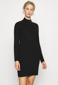 Calvin Klein Jeans - ROLL NECK DRESS - Jumper dress - black - 0