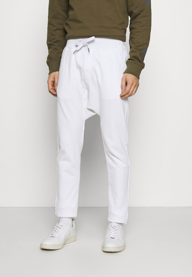 PAUL - Tracksuit bottoms - white
