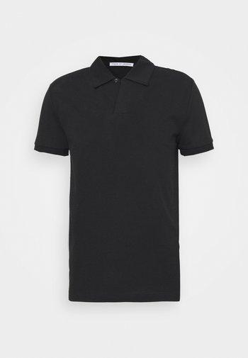 ADERICO - Polo shirt - black