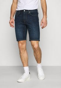 Levi's® - 502™ TAPER SHORTS - Denim shorts - dark indigo - 0