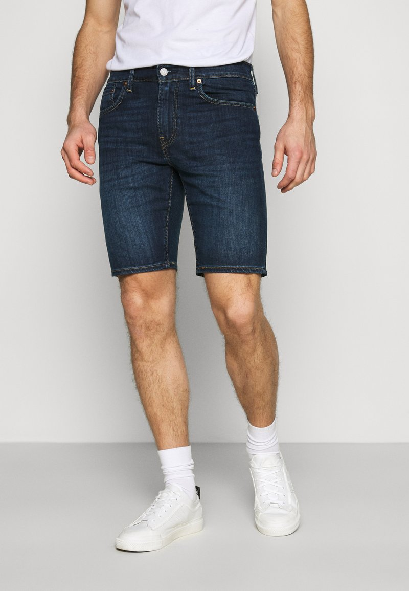 Levi's® - 502™ TAPER SHORTS - Denim shorts - dark indigo