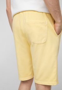 s.Oliver - Tracksuit bottoms - yellow - 5