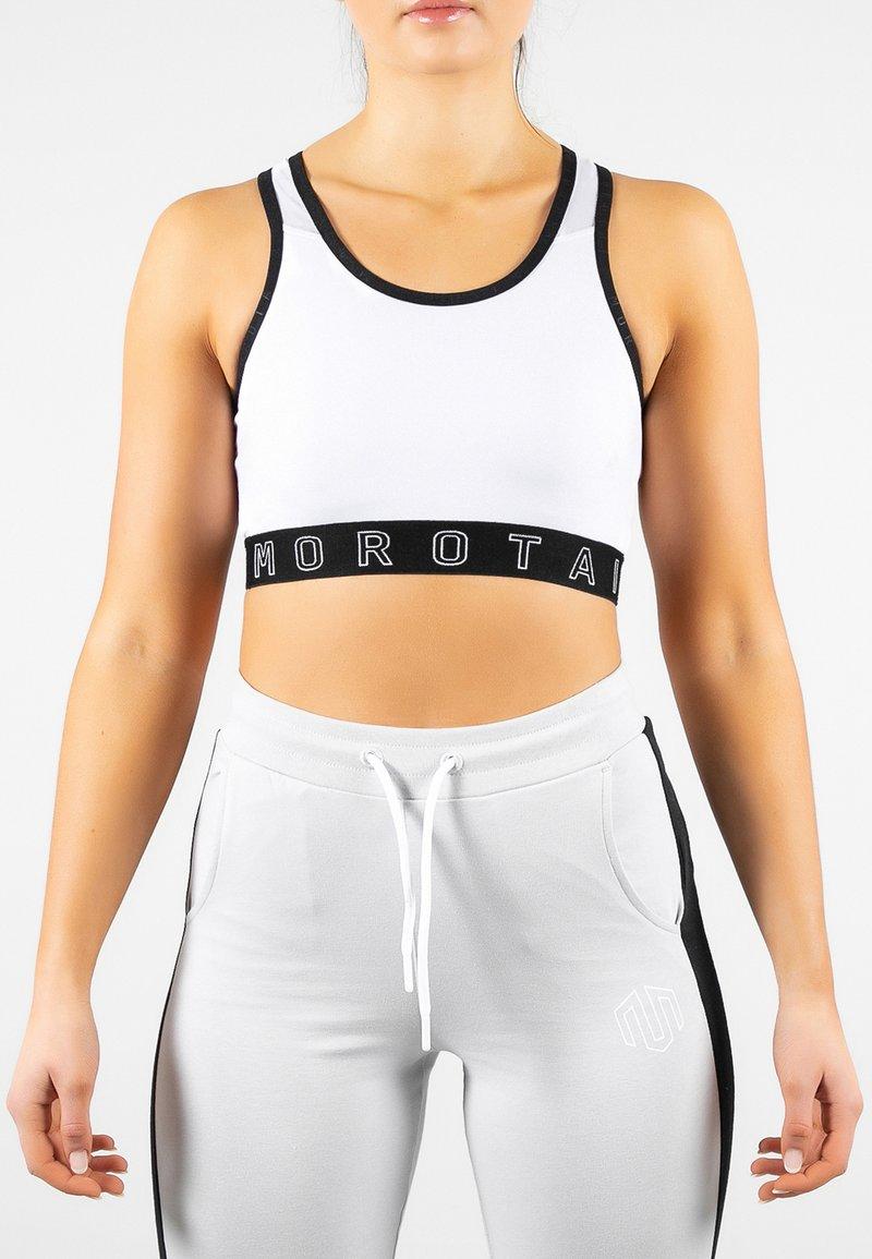 MOROTAI - NAKA  - Sports bra - white