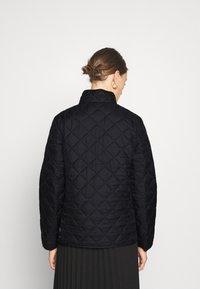 Selected Femme - SLFPLASTICCHANGE QUILTED JACKET - Light jacket - black - 2