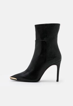 SILLA - Kotníková obuv na vysokém podpatku - nero