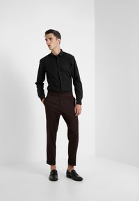 Filippa K - TERRY CROPPED PANTS - Trousers - deep shira - 1