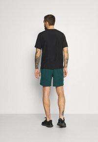 Under Armour - SHORTS - Sports shorts - dark cyan - 2