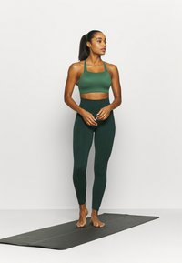 Nike Performance - LUXE BRA - Medium support sports bra - pro green/vintage green - 1