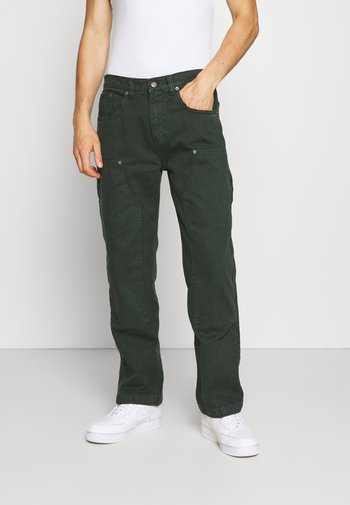 WASHED CARPENTER - Relaxed fit jeans - green