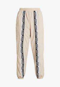 adidas Originals - TRACK PANTS - Trousers - ash pearl - 4