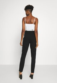 JDY - JDYTANJA  - Trousers - black - 2