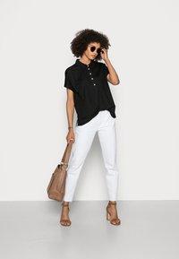 comma - Polo shirt - black - 1