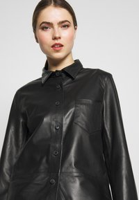 STUDIO ID - RIKE - Button-down blouse - black - 4