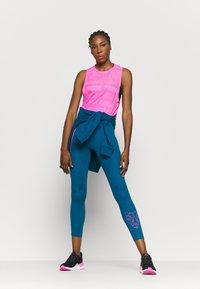 Puma - TRAIN FIRST MILE XTREME TANK - Sports shirt - luminous pink - 1