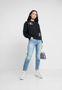 Calvin Klein Jeans - HIGH RISE SLIM ANKLE - Džíny Slim Fit - honcho blue - 1