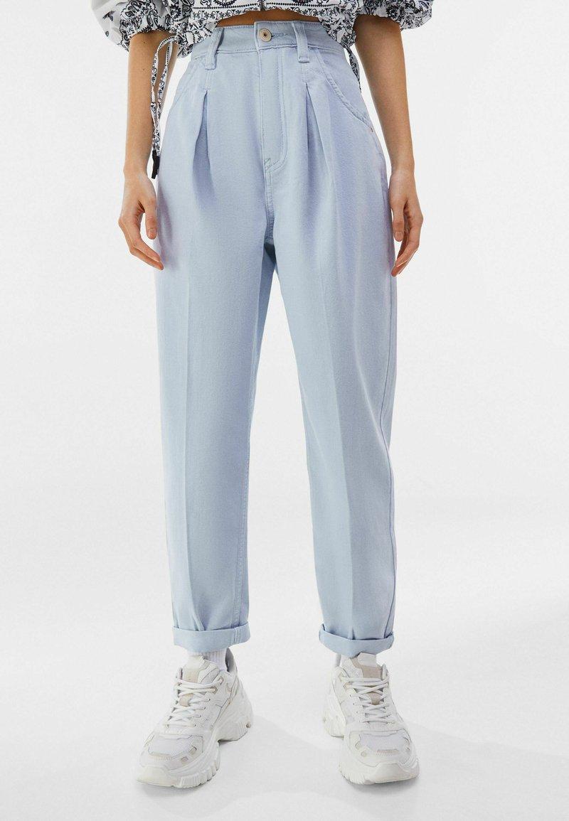 Bershka - Trousers - light blue