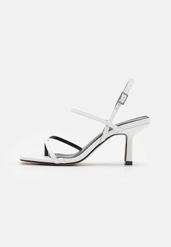 SAWYER - T-bar sandals - white