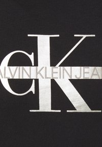 Calvin Klein Jeans - SEASONAL MONOGRAM TEE UNISEX - Print T-shirt - black - 6