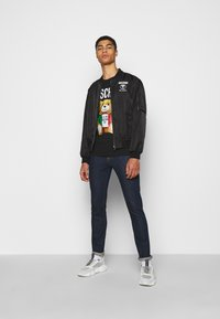 MOSCHINO - TROUSERS - Slim fit jeans - fantasy blue - 1