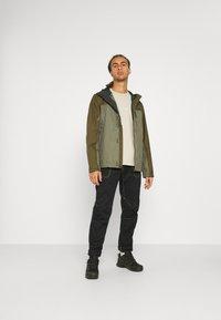 Columbia - POURING ADVENTURE JACKET - Hardshell jacket - stone green/new olive - 1