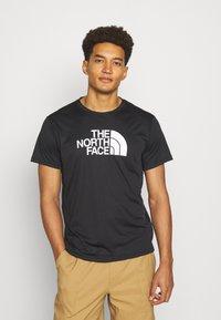 The North Face - MENS REAXION EASY TEE - Camiseta estampada - black - 0