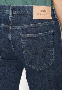 Edwin - TAPERED - Straight leg jeans - blue denim - 4