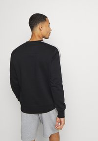 Jack & Jones Performance - JCOZ SPORT CREW NECK - Sweatshirt - black