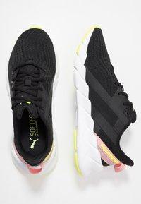 Puma - WEAVE XT SHIFT - Sports shoes - black/white - 1