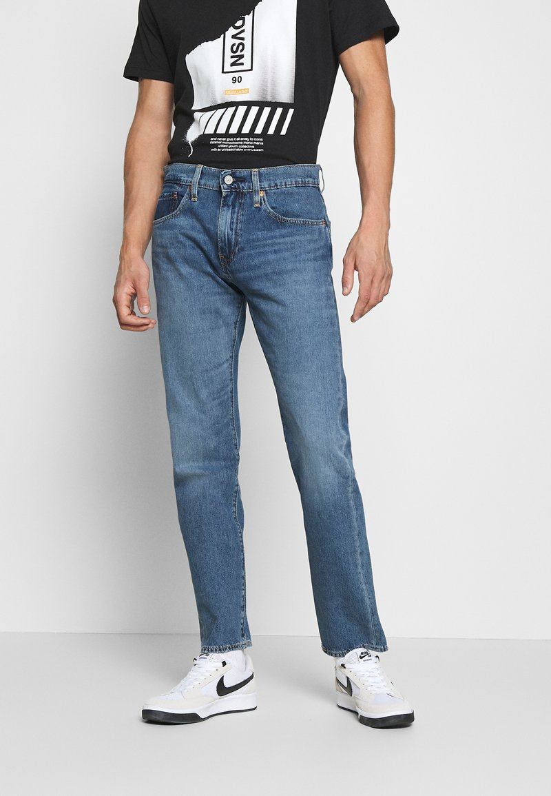 Levi's® - 502™ TAPER - Jeans Tapered Fit - med indigo