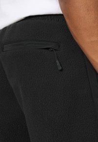 Redefined Rebel - EDRIC PANTS - Tracksuit bottoms - black - 5