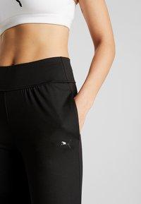 Puma - STUDIO TAPERED PANT - Pantalones deportivos - puma black - 3