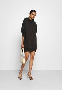 Missguided - PLAYBOY OVERSIZED LOGO HOODY DRESS - Day dress - black - 1