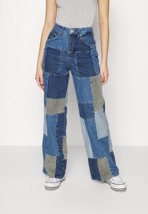 PATCHWORK PUDDLE - Flared jeans - denim