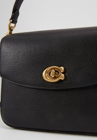 Coach - POLISHED PEBBLED CASSIE CROSSBODY - Handbag - black - 6
