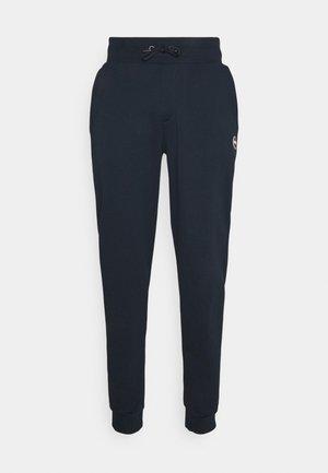 MENS PANTS - Tracksuit bottoms - dark blue
