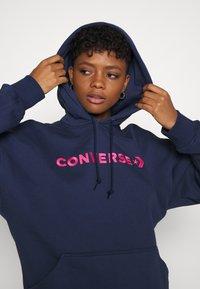 Converse - EMBROIDERED OVERSIZED HOODIE - Sweatshirt - midnight navy - 4