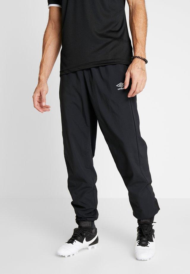 TRAINING PANT - Teplákové kalhoty - black