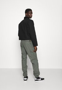 Carhartt WIP - JOGGER COLUMBIA - Cargo trousers - thyme rinsed - 3