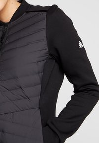 adidas Performance - VARILITE HYBRID HOODED WINTER - Winter jacket - black