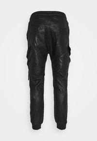 Tigha - TANO - Leather trousers - black - 7