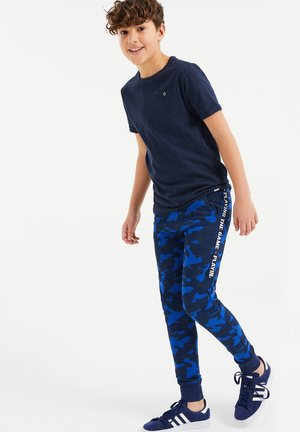 Tracksuit bottoms - all-over print