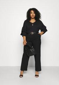 Anna Field Curvy - Trousers - black - 1