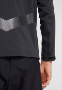 Nike Golf - Waterproof jacket - off noir/black/photo blue - 6