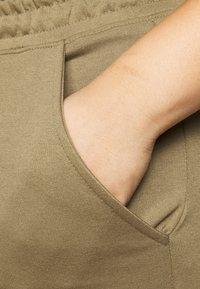 Missguided Plus - UTILITY POCKET HIGH WAISTED - Tracksuit bottoms - khaki - 4