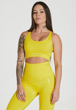 ESSENTIAL SEAMLESS - Sports bra - yellow