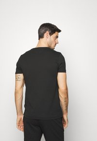 Tommy Hilfiger - TH COOL  - T-shirt con stampa - black - 2