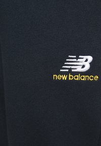 New Balance - ESSENTIALS EMBRIODERED PANT - Tracksuit bottoms - dark blue - 4